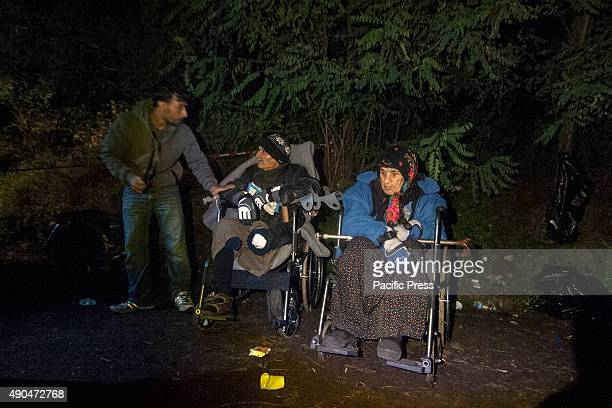 BORDER BAPSKA SYRMIA CROATIA Disabled refugees wait to cross the border to get in Croatia Desperate migrants continue their journey to Europe to...
