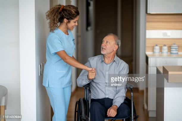 disabled senior man greeting his home cargiver - diabetic amputation stock pictures, royalty-free photos & images