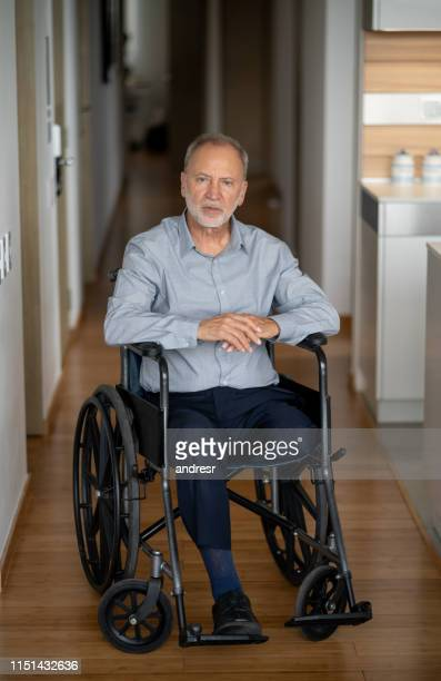 disabled senior man in a wheelchair at home - diabetic amputation stock pictures, royalty-free photos & images