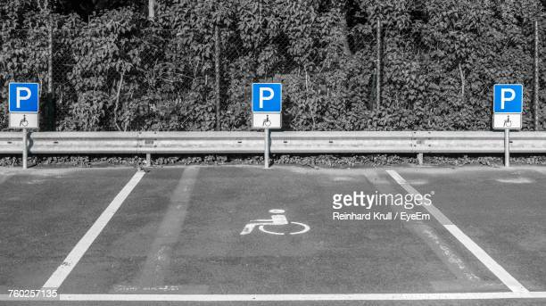 Disabled Sign At Parking Lot During Sunny Day