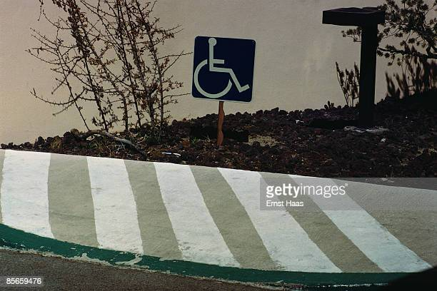 A disabled sign behind a painted wall California USA March 1977