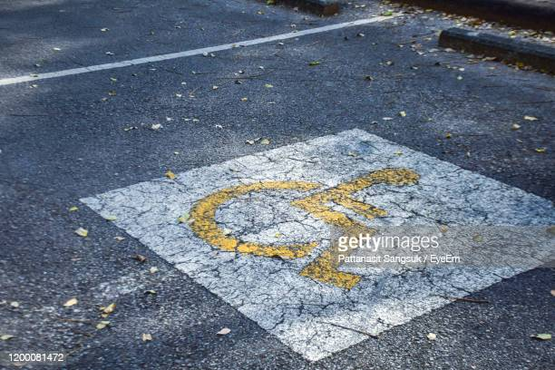 disabled sign on road - pattanasit stock pictures, royalty-free photos & images