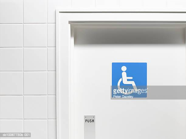 Disabled sign on toilet door, close-up