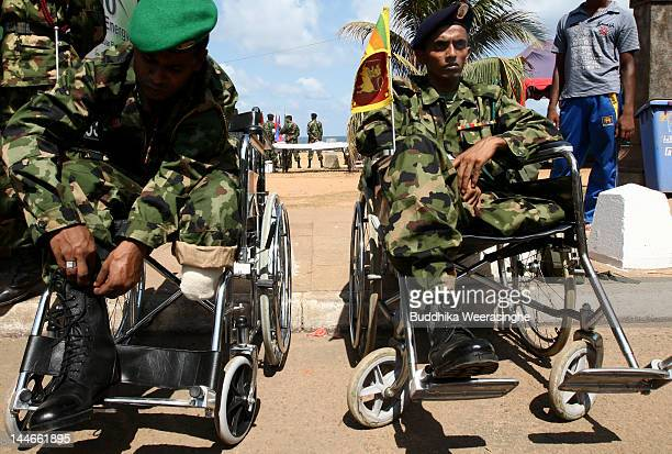 A disabled Sri Lankan Army officer prepares his boot during military parade rehearsals in preparation for the celebration of the third anniversary of...