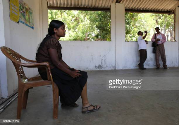 A disabled Sri Lankan ethnic Tamil war survivor woman named Nathan Mohan Priya 20 years old sits during the voter education programme which is held...