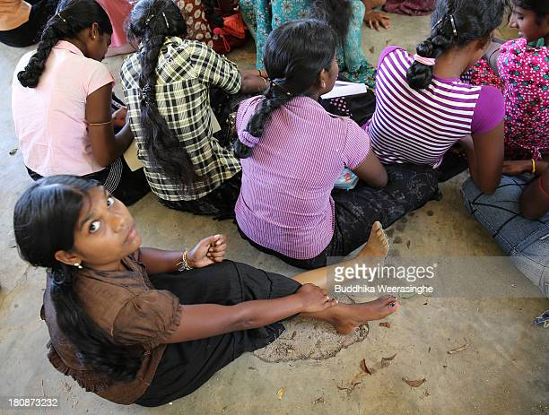 A disabled Sri Lankan ethnic Tamil war survivor woman named Nathan Mohan Priya 20 years old during the voter education programme which is held by...