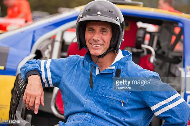disabled stock car racer with spinal cord injury in wheelchair with his modified race car - will power race car driver stock photos and pictures