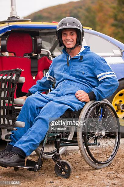 disabled stock car racer with spinal cord injury in wheelchair with his modified race car - will power race car driver stock pictures, royalty-free photos & images