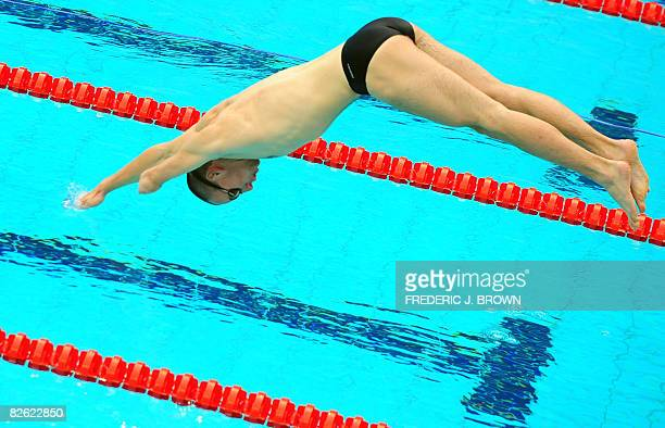 A disabled swimmer's hand touches the water while diving into the pool during a training session on September 2 2008 in Beijing at the National...