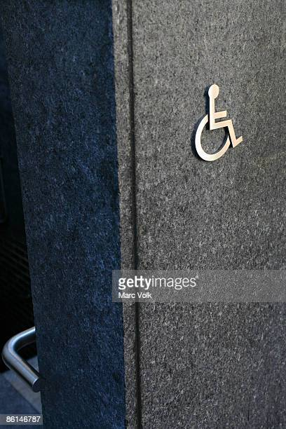 A disabled symbol on a wall