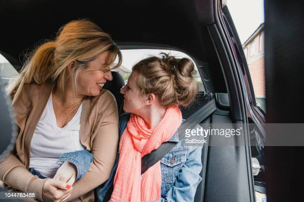 disabled teenager excited for a road trip with mum - epilepsy stock pictures, royalty-free photos & images