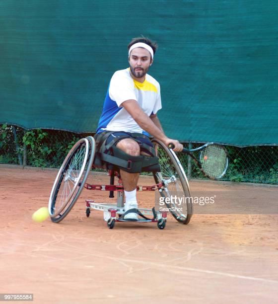 無効のテニスプレーヤー - 車いすテニス ストックフォトと画像