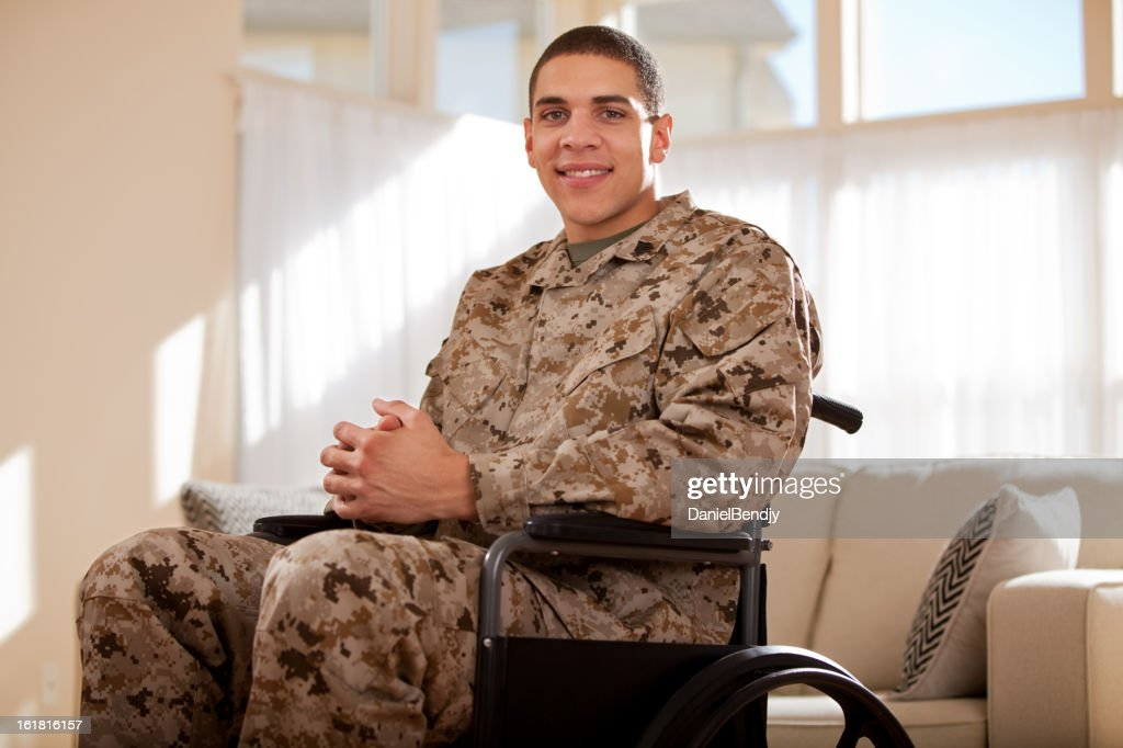 Disabled Veteran US Marine Soldier in Wheelchair : Stock Photo