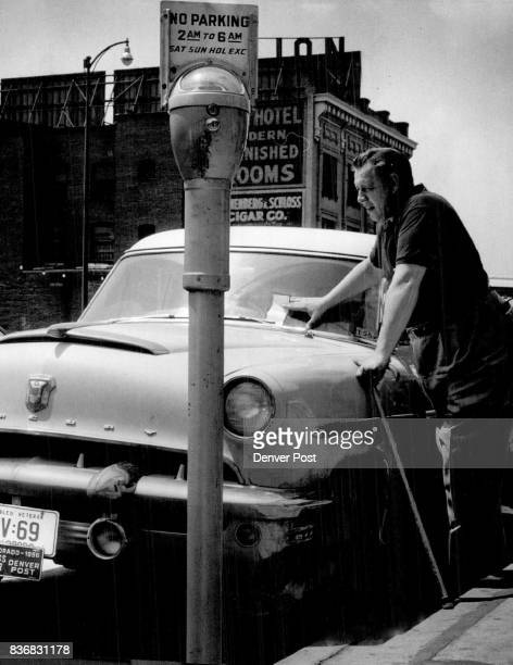 Disabled Veterans Ray Krolicki disabled World War II veteran and Denver Post staff artist eyes the parking ticket hung on his car early Monday as...