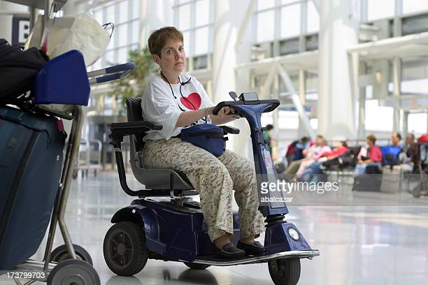 disabled waiting at a check-in line