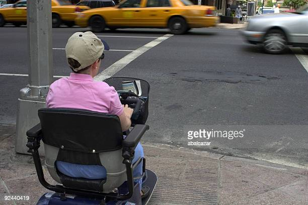 disabled waiting to cross - mobility scooter stock photos and pictures