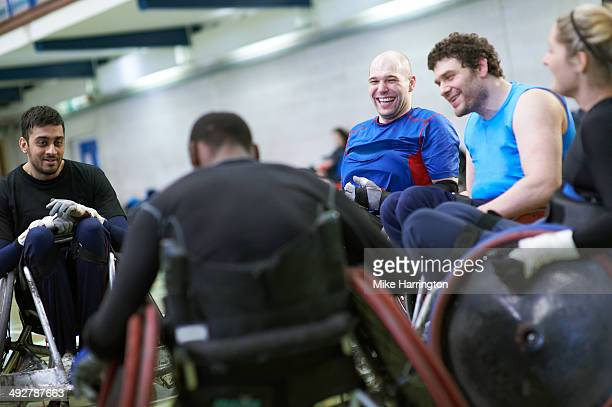 disabled wheelchair rugby athletes in sports hall - five people stock pictures, royalty-free photos & images