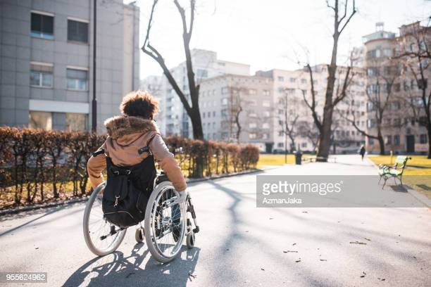 Disabled woman in a wheelchair in the park