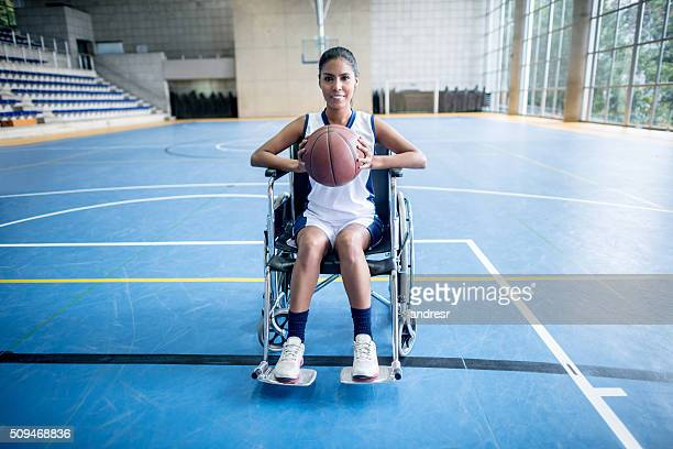 Disabled woman playing basket