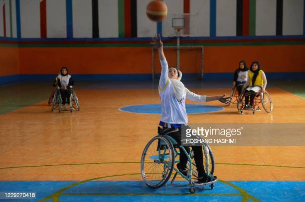 Disabled women take part in a female wheelchair basketball friendly match as part of a polio campaign organised by the United Nations Children's Fund...