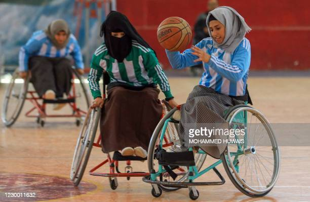 Disabled Yemeni women take part in a local wheelchair basketball championship in Yemen's capital Sanaa on December 8, 2020. - In conflict-ridden...