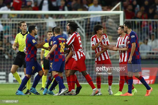 A disagreement between the teams breaks out during the Supercopa de Espana SemiFinal match between FC Barcelona and Club Atletico de Madrid at King...