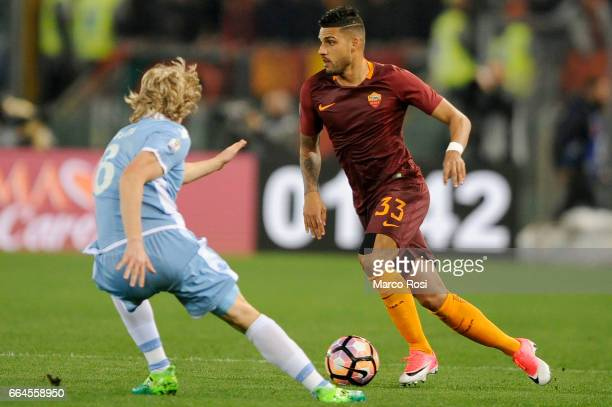 Disan Basta of SS Lazio battles with Emerson Palmieri of AS Roma during the TIM Cup match between AS Roma and SS Lazio at Stadio Olimpico on April 4...