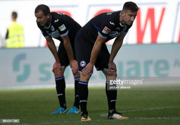 Disappointed Bielefeld players Manuel Prietl Andraz Sporar seen on the pitch after the German Second Bundesliga soccer match between Darmstadt 98 and...