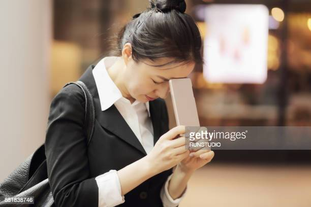 Disappointed businesswoman with smartphone