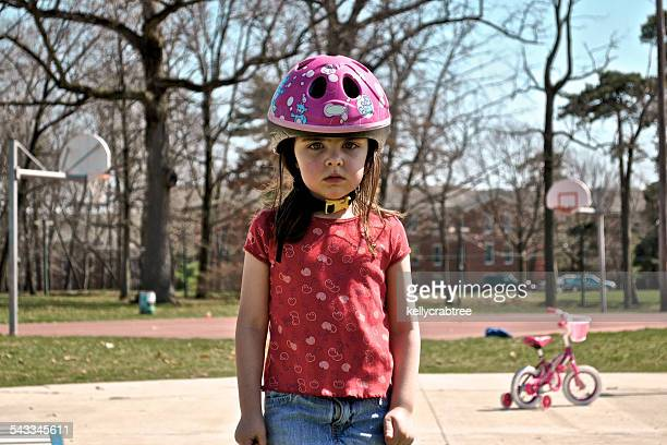 disappointed child (4-5) in bike helmet - disappointment stock pictures, royalty-free photos & images