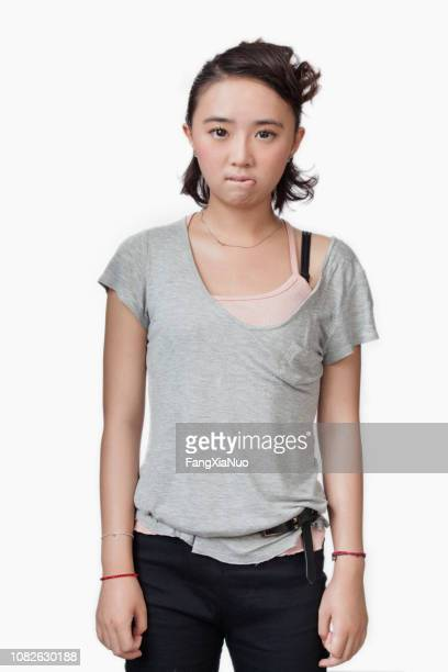 disappointed chinese woman - biting lip stock pictures, royalty-free photos & images