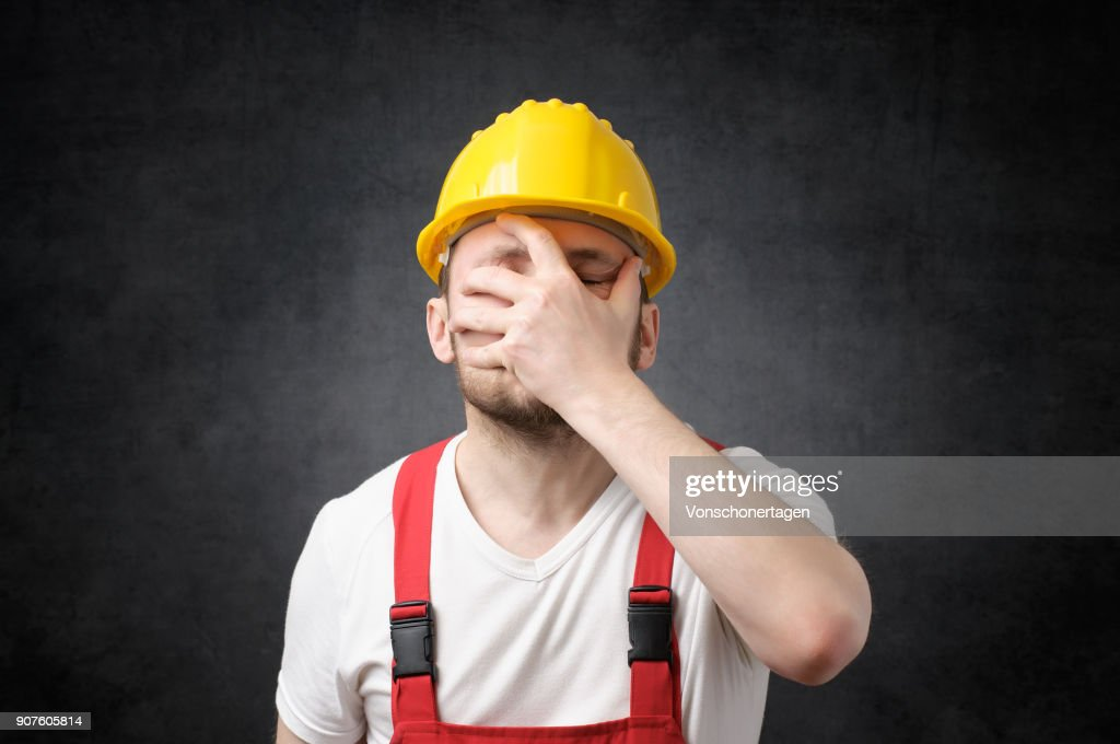Disappointed construction worker : Stock Photo