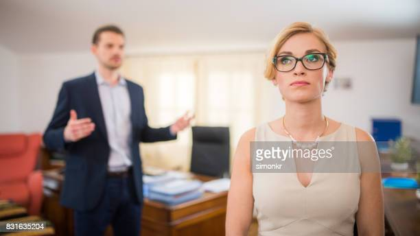 disappointed coworker - nude colored pants stock photos and pictures
