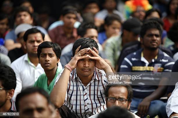 Disappointed fans after the Indian Cricket team lost the Cricket world cup semifinal match against Australia at Select City Walk mall on March 26...