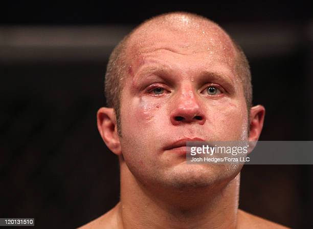 Disappointed Fedor Emelianenko stands in the cage after his loss to Dan Henderson by TKO in a heavyweight fight at the Strikeforce event at Sears...
