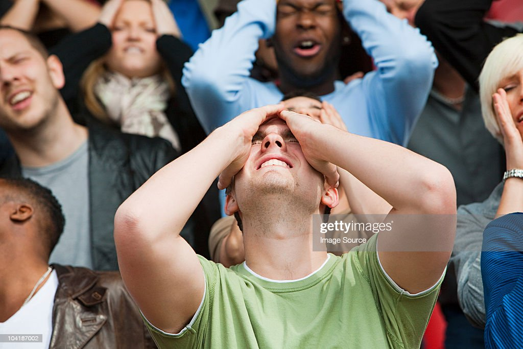 Disappointed football fan : Stock Photo