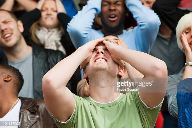 disappointed football fan - fan enthusiast stock photos and pictures