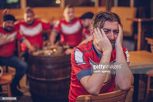 disappointed football fans - defeat stock pictures, royalty-free photos & images