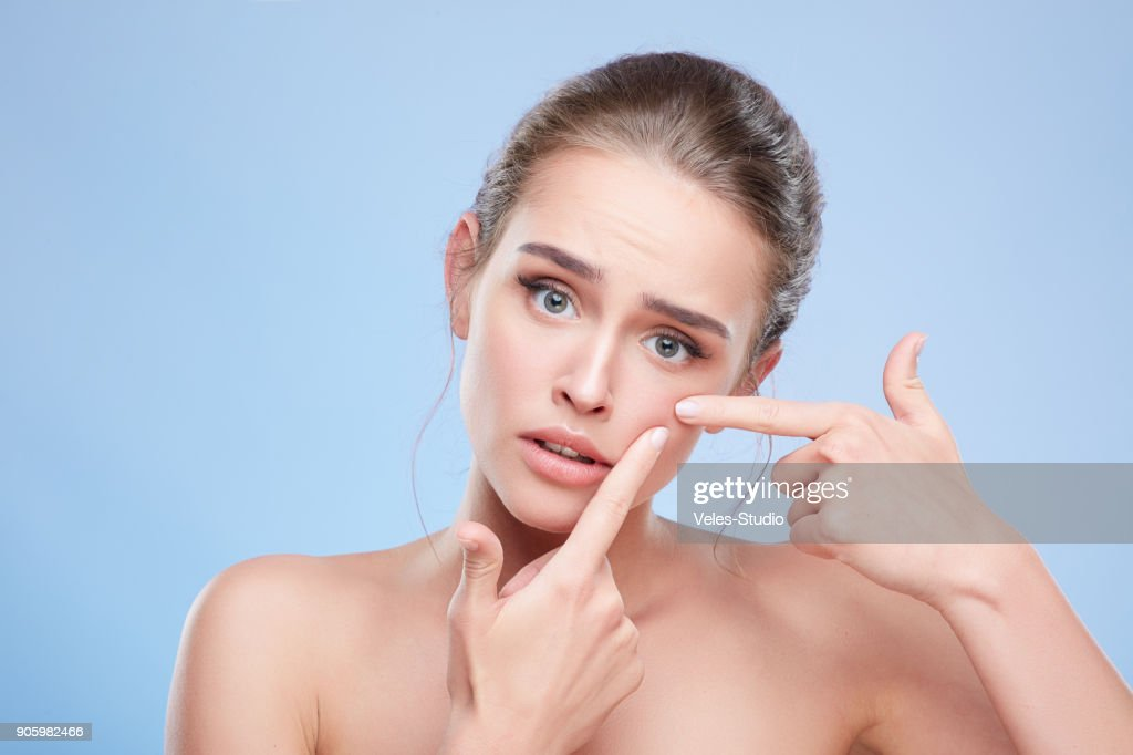 Disappointed girl looking at camera : Stock Photo