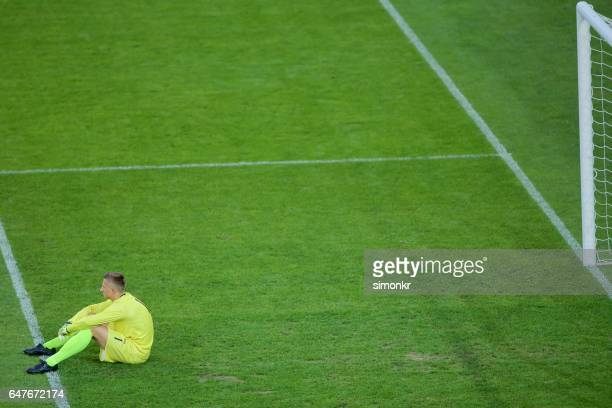 disappointed goalkeeper - goalkeeper stock pictures, royalty-free photos & images