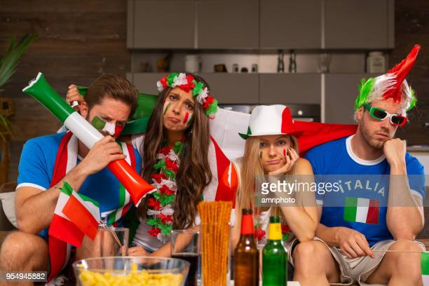 disappointed italian sports fans - italy football stock photos and pictures