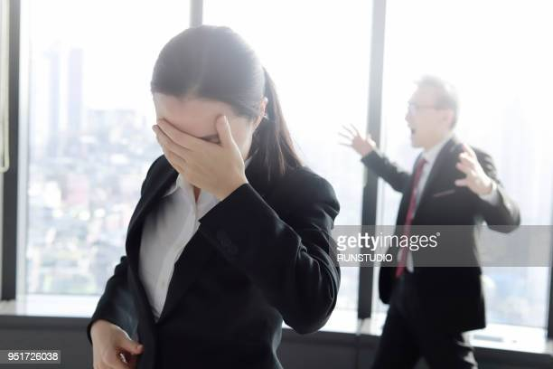 disappointed looking business people in empty office - distressed stock market people stock pictures, royalty-free photos & images