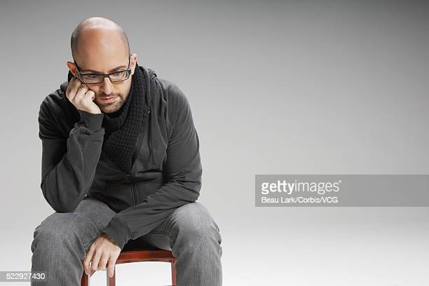 Disappointed man sitting on a chair