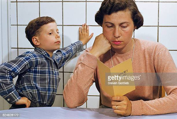 Disappointed Mother Reading Son's Report Card