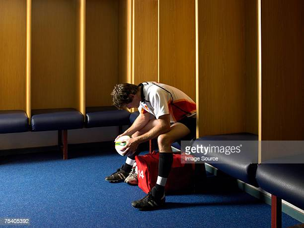 disappointed rugby player - rugby players in changing room stock photos and pictures
