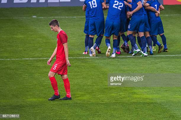 disappointed soccer player - defeat stock photos and pictures