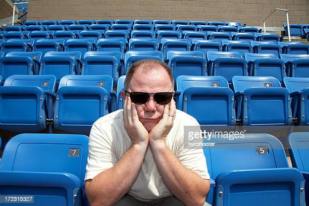 disappointed sports fan - empty bleachers stock photos and pictures