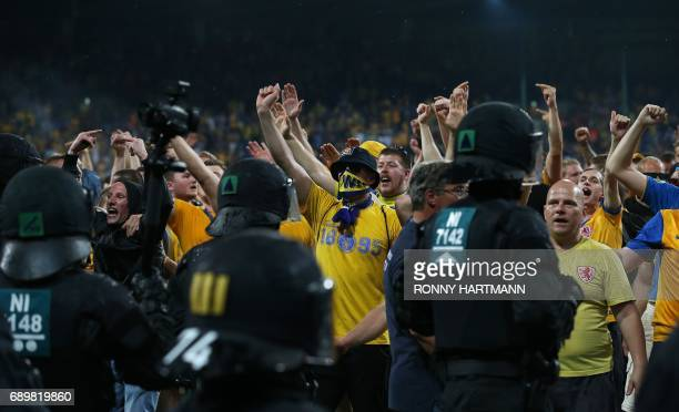 Disappointed supporters of Braunschweig enter the pitch after after German Bundesliga relegation second leg football match between Eintracht...