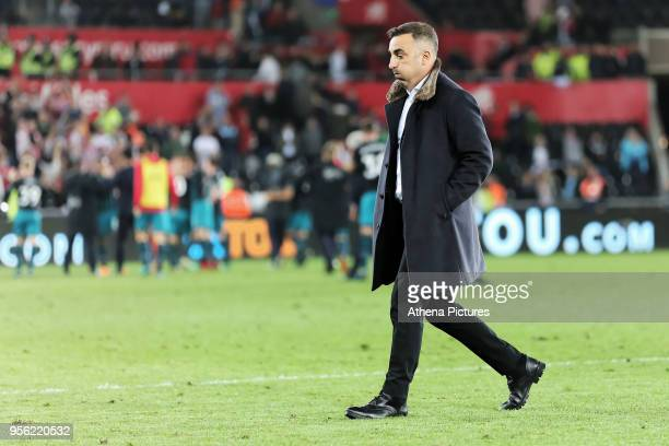 A disappointed Swansea manager Carlos Carvalhal walks off he pitch during the Premier League match between Swansea City and Southampton at The...