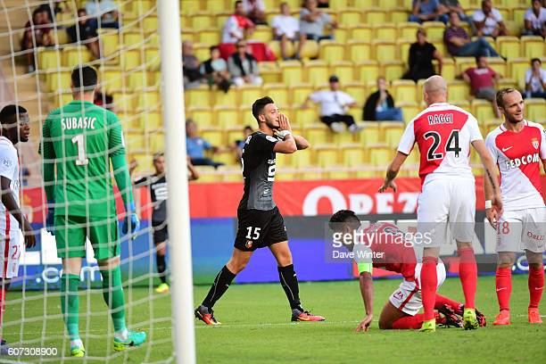 Disappointment for Ramy Bensebaini of Rennes as he heads wide during the French Ligue 1 match between AS Monaco and Stade Rennais at Louis II Stadium...